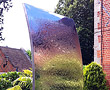Sail - mirror polished surface used to bring light, colour and movement to a  private garden