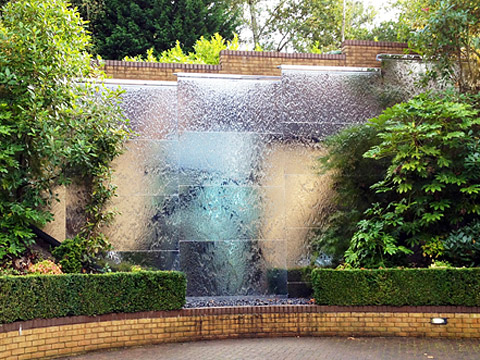 Water wall - 10m wide, 4.5m tall - mirror polished stainless steel - private residence, Weybridge
