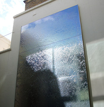 Water Wall - 5m - mirror polished stainless steel - private residence, Belgravia